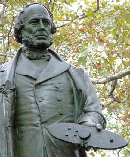 A statue of John Ericsson, the Monitor's inventor, in Battery Park, New York City, with a <em>Monitor</em> model in hand