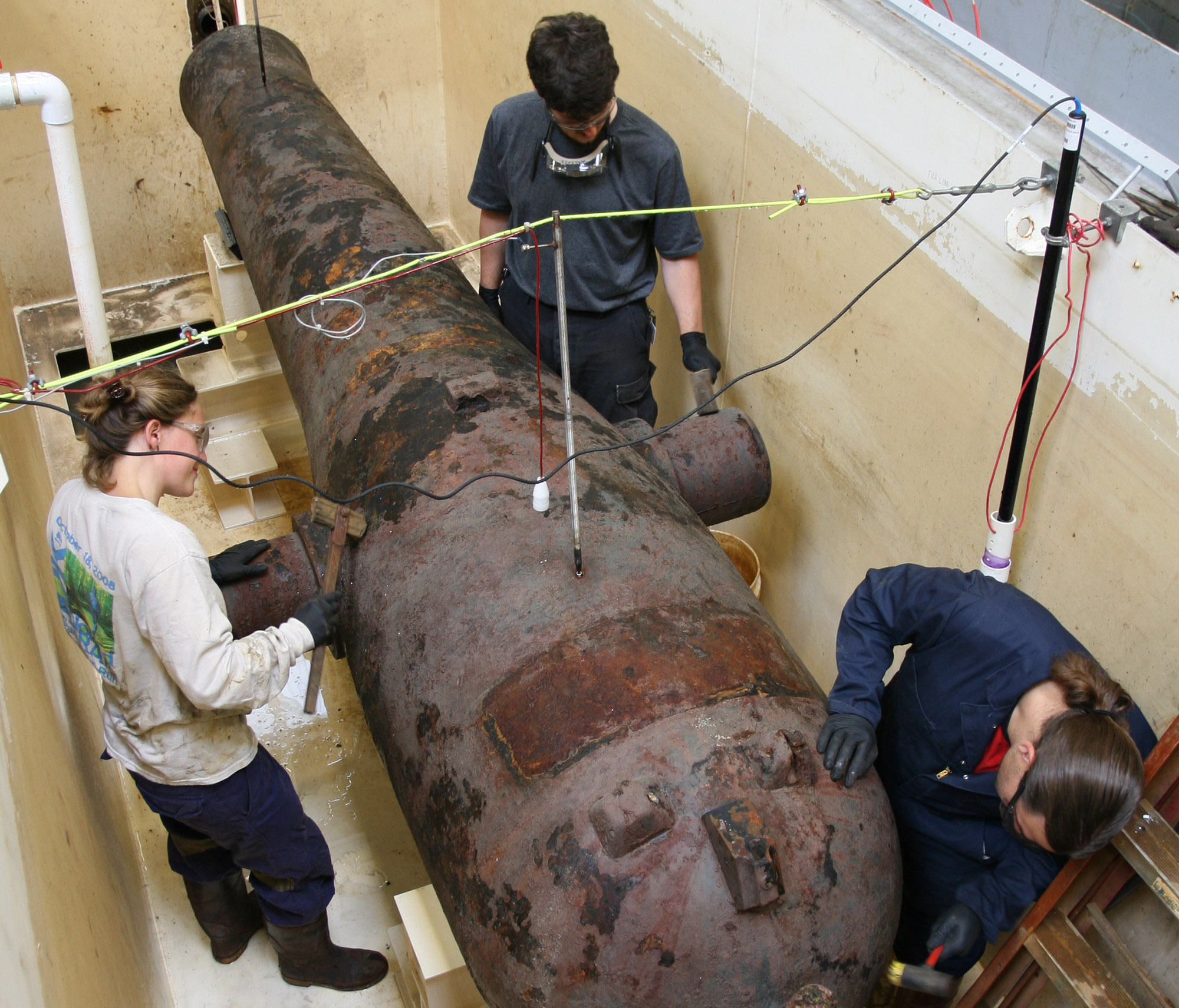 Museum conservators inspect one of the Monitor's Dahlgren guns