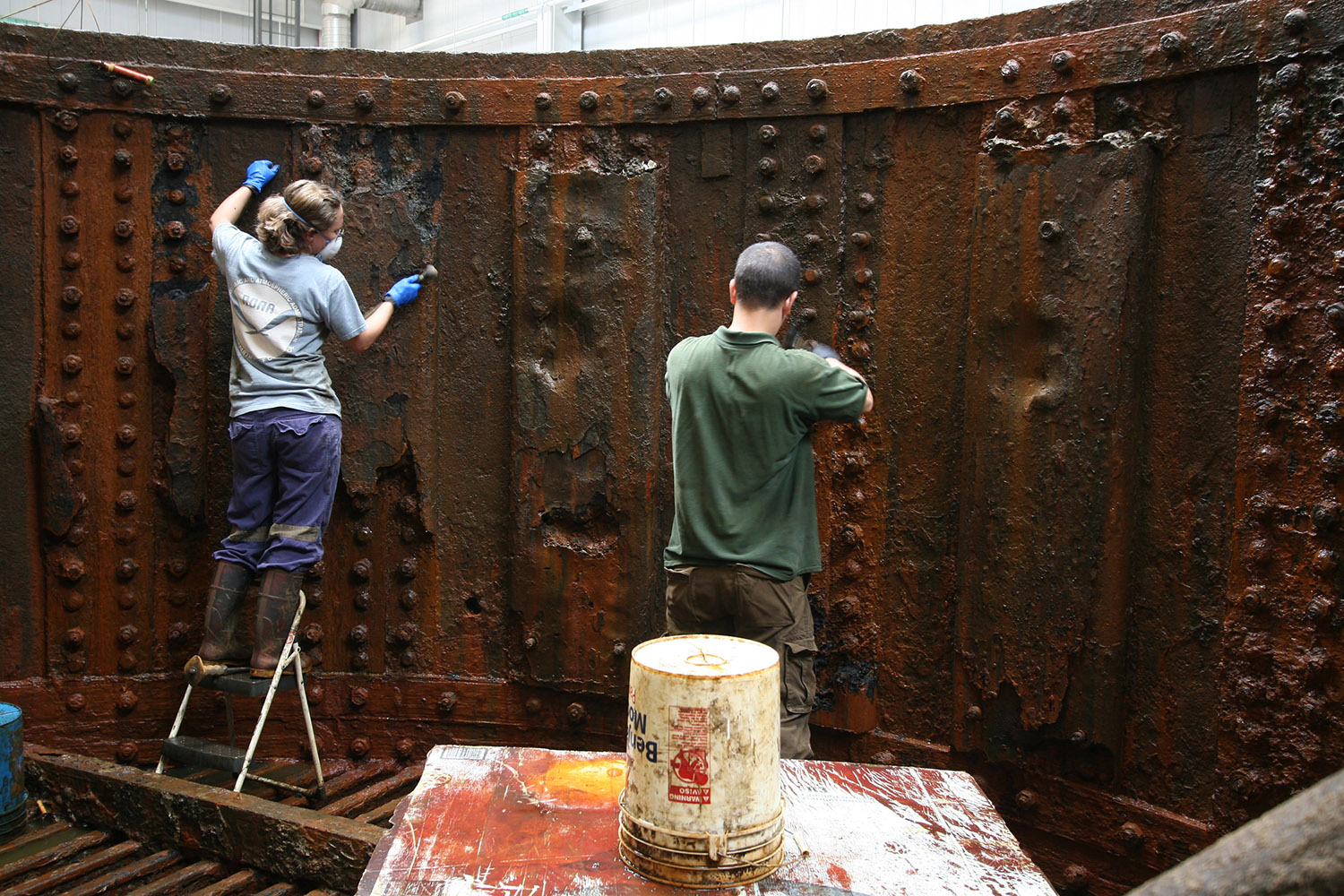 Museum Conservators working on the inside of the Monitor's turret